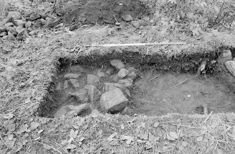 Inverlochy Castle Frame 33 - Trench E with rubble partially removed; from northeast