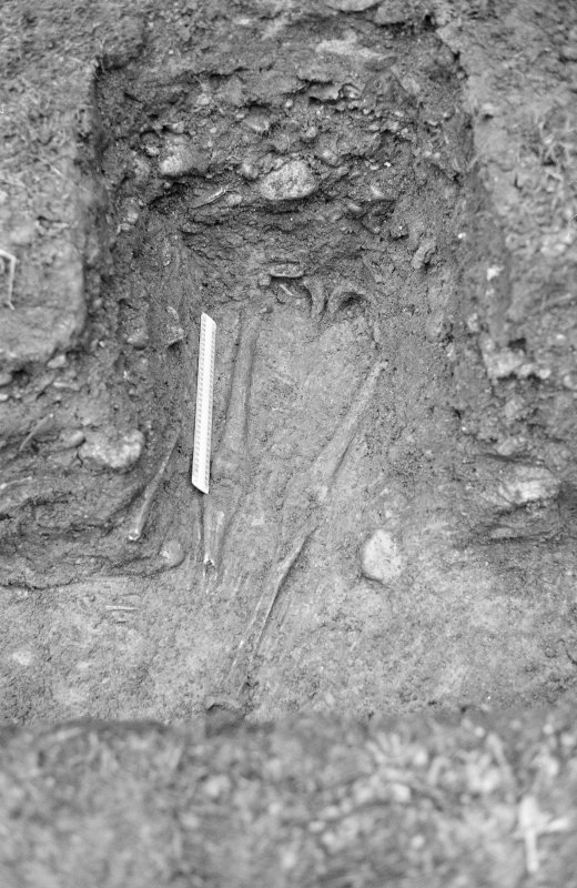 Inverlochy Castle Frame 10 - Legs of skeleton F709 in drain trench; from east