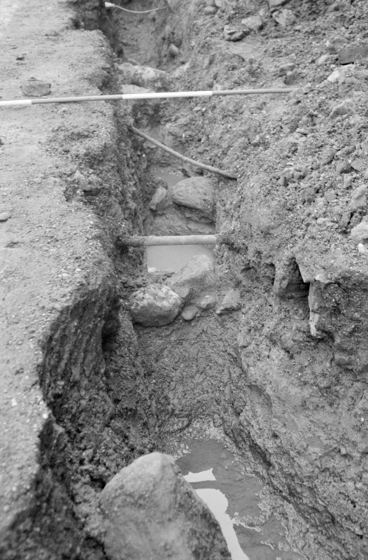 Newark Castle Frame 23 - Trench L: remnant of wall below pipe - from north
