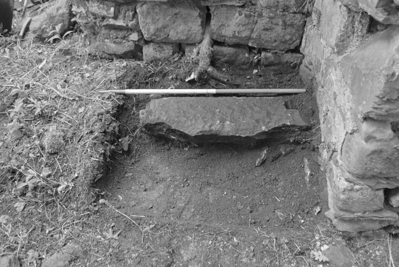 Rossdhu Castle Excavations, June and August/September 1996 Frame 10 - Trench 5 showing architectural fragment in situ - from west