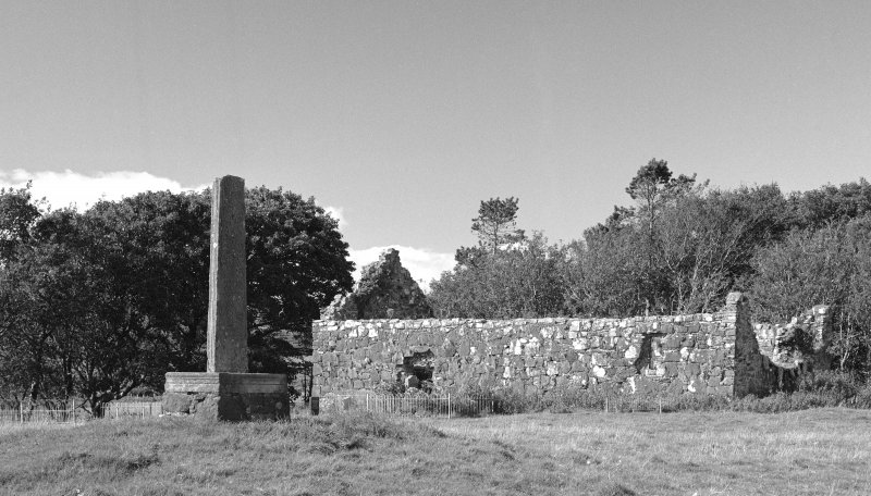 View of cross shaft and St Donnan's Church, Kildonnan, Eigg, from SE.