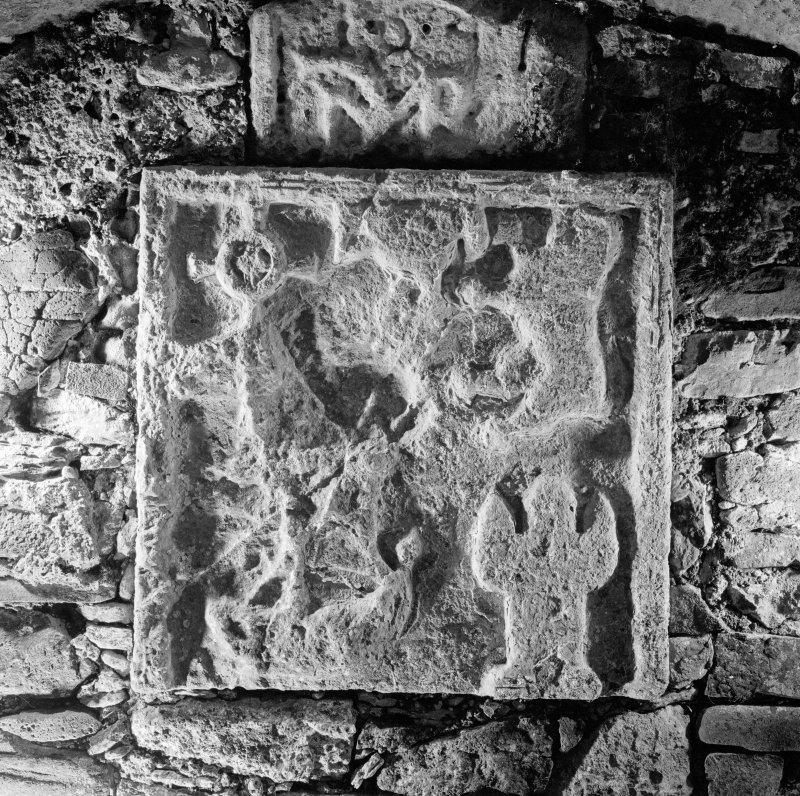 View of tomb recess in N wall showing detail of ornamental panel, St Donnan's Church, Kildonnan, Eigg.