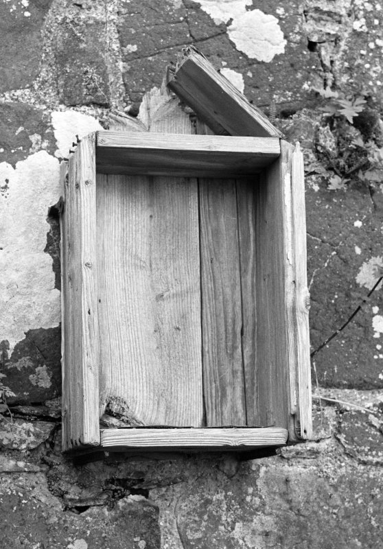 View of wooden cabinet on W wall, formally containing carved stone, St Donnan's Church, Kildonnan, Eigg.