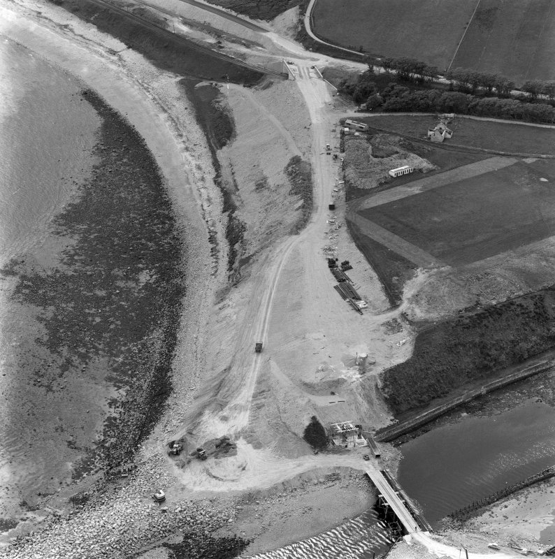 Oblique aerial view of bridge under construction and the site of Helmsdale Castle.