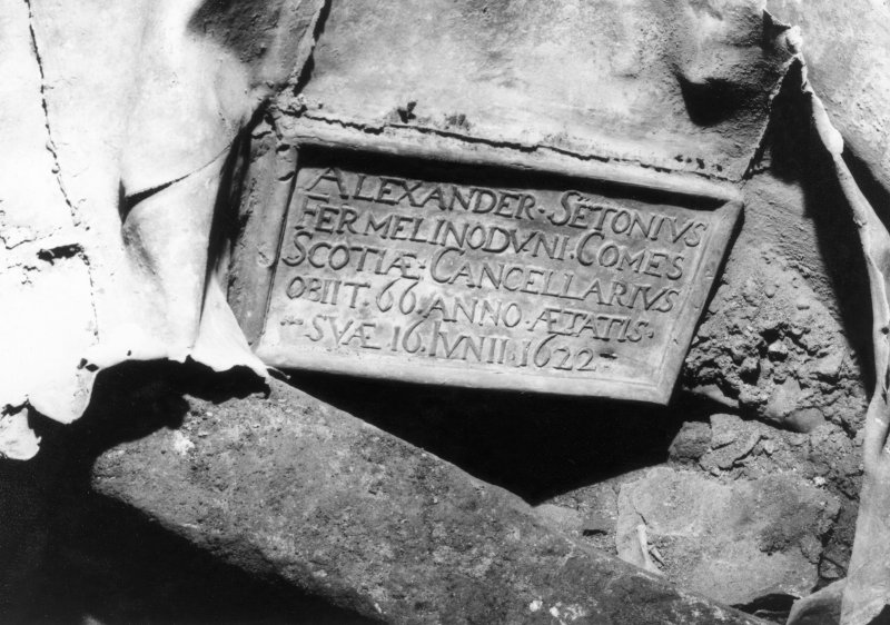 Photographic copy of original image showing plaque at West end of lead coffin from West. (Grave 8)