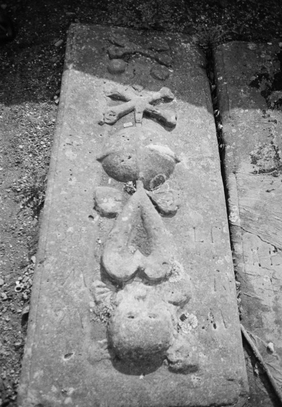 View of gravestone with initals AM and WW dated 1788, in the churchyard of New Kilpatrick Parish Church.