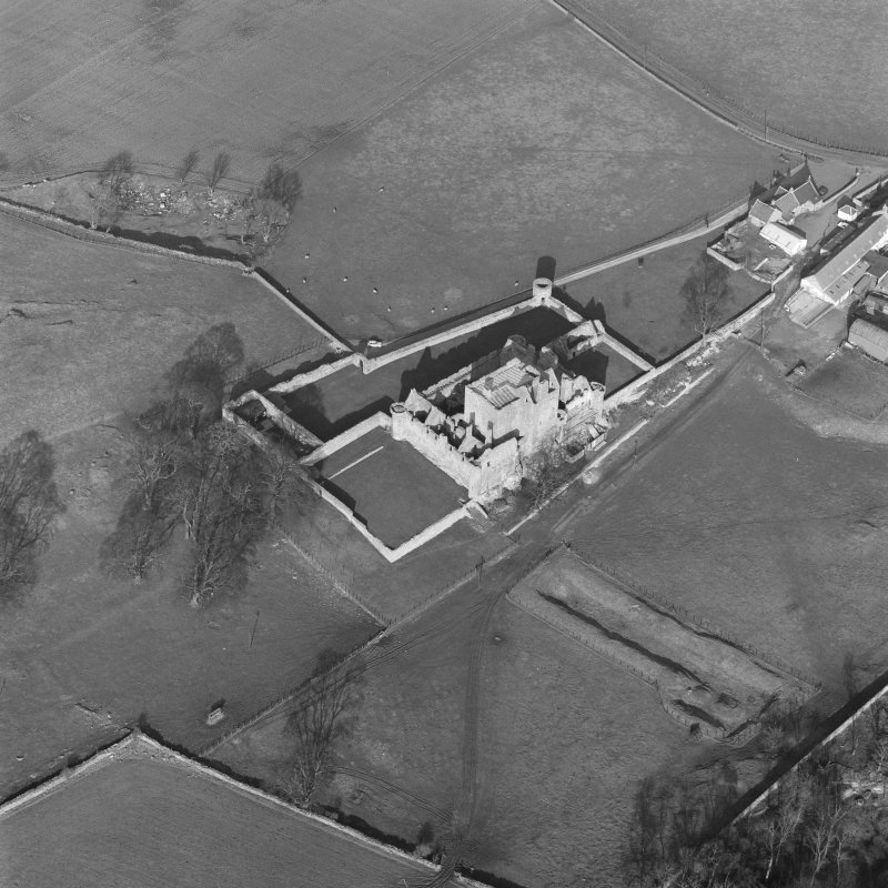 Oblique aerial view of Craigmillar Castle, Edinburgh, from SW.