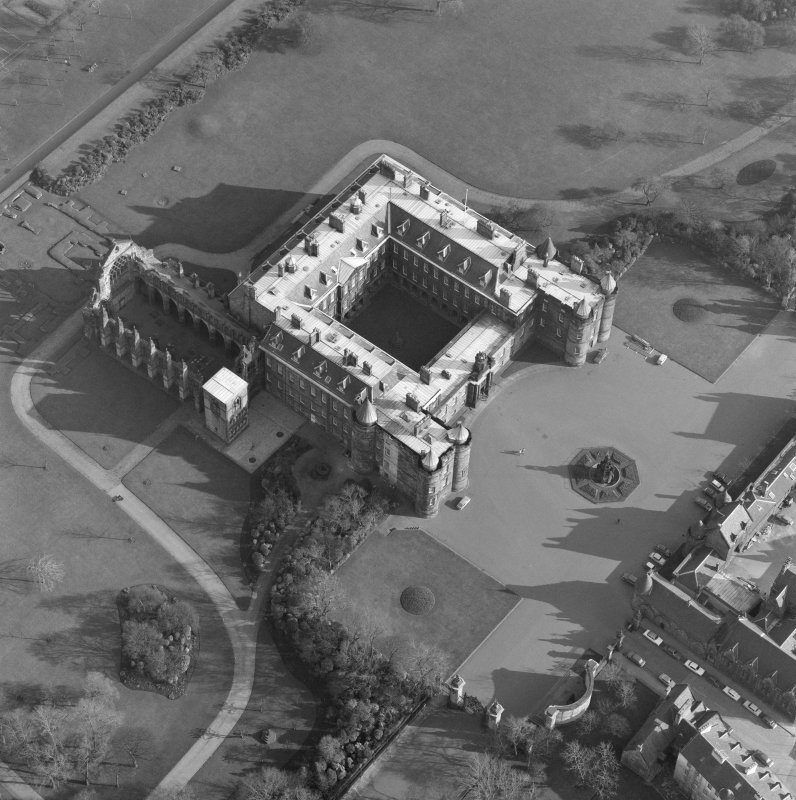 Oblique aerial view of Holyrood Palace and Abbey, Edinburgh, with fountain also visible.