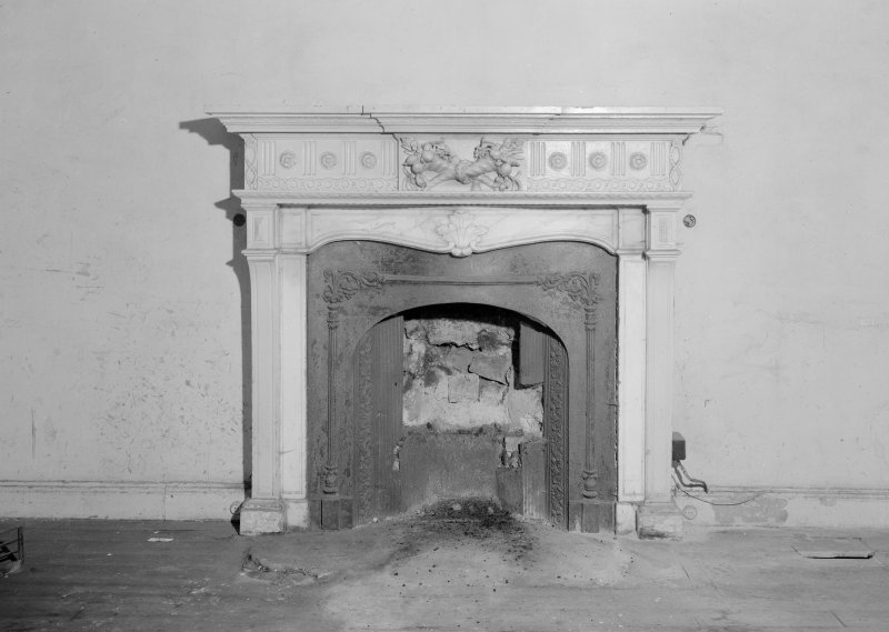 Interior view of Fordell House showing detail of wooden chimney piece in room at ground floor back.