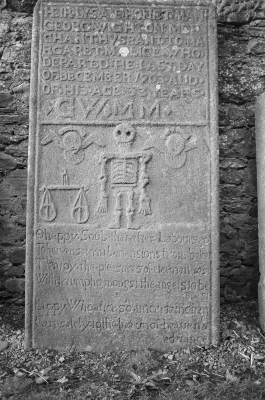 View of gravestone for George Wighton dated 1703, in the churchyard of Coupar Angus Abbey Church.