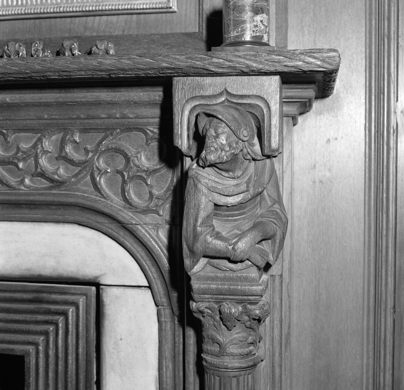 Library, detail carved figure on fireplace