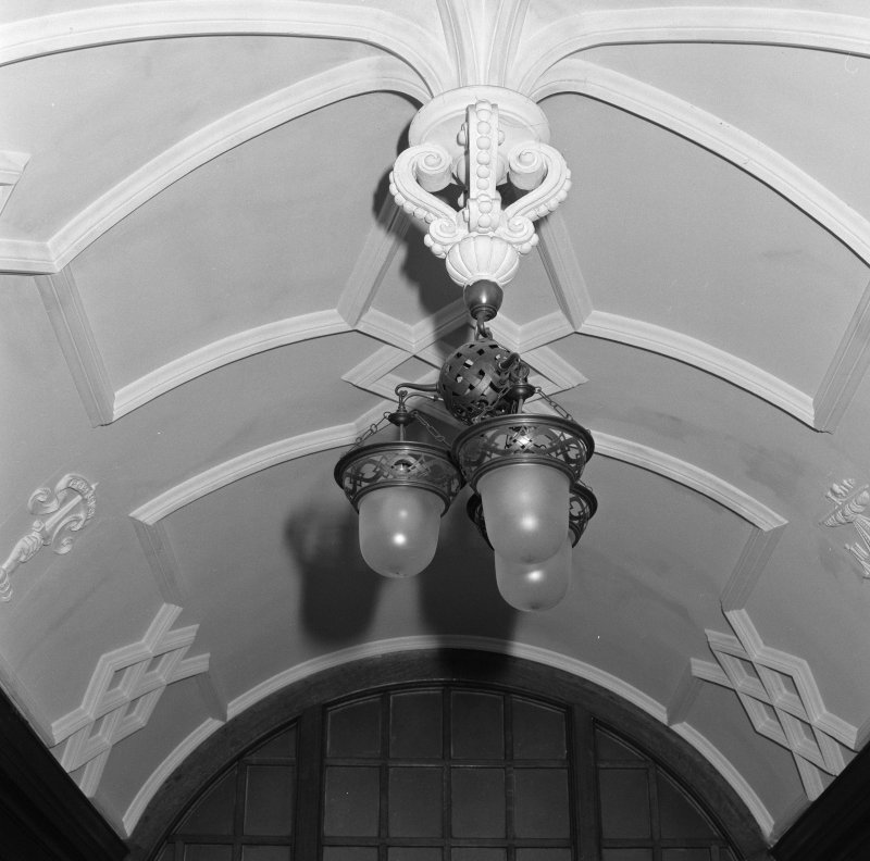Cloakroom lobby, detail of electric light fitting