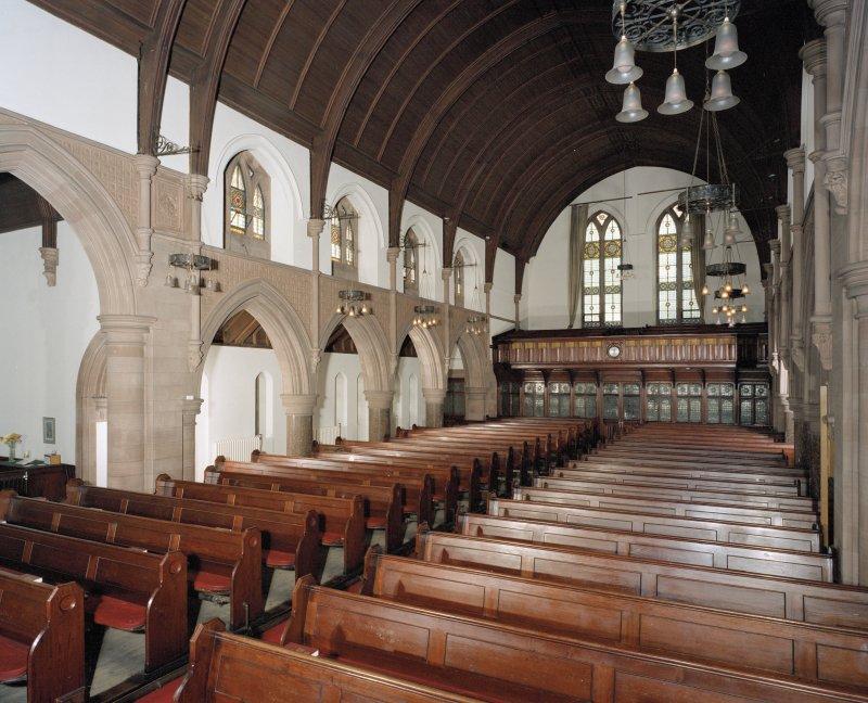 Interior.  View of aisle and pews.