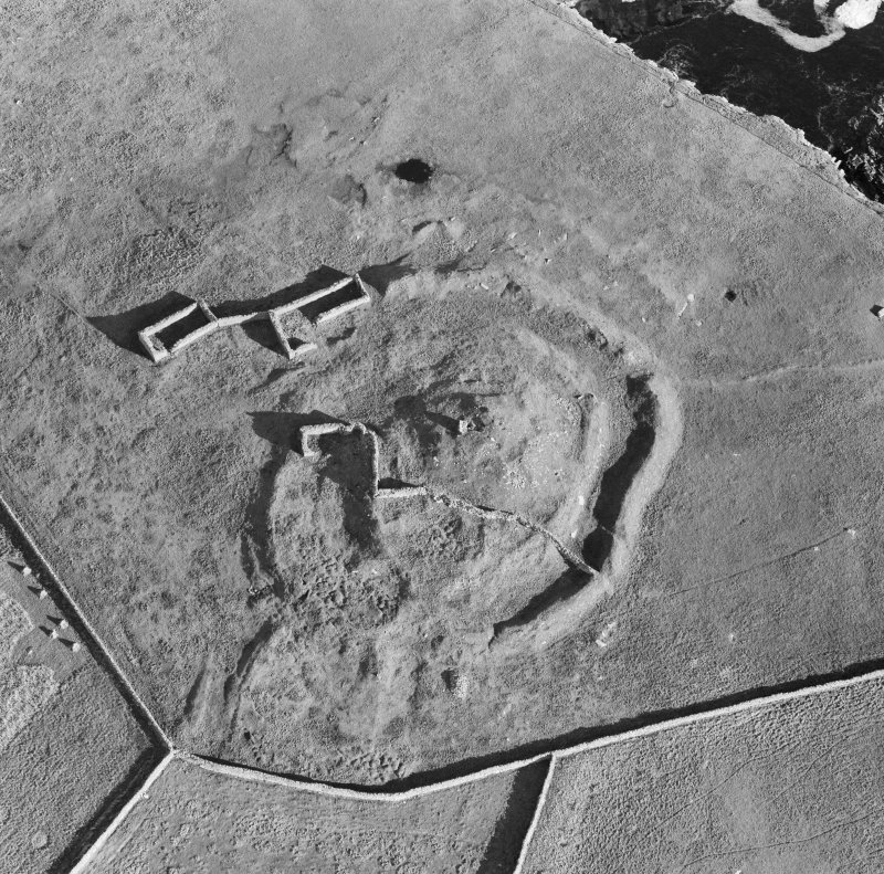 Oblique aerial view centred on the remains of the broch at Dalsetter.