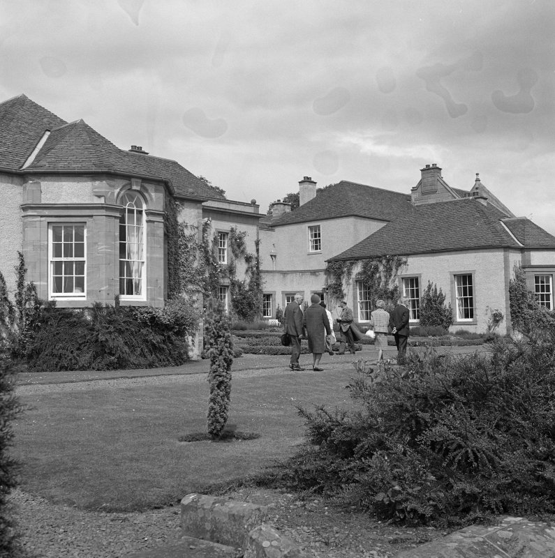 View of wings flanking core former farmhouse from SW after Schomberg Scott remodelling.