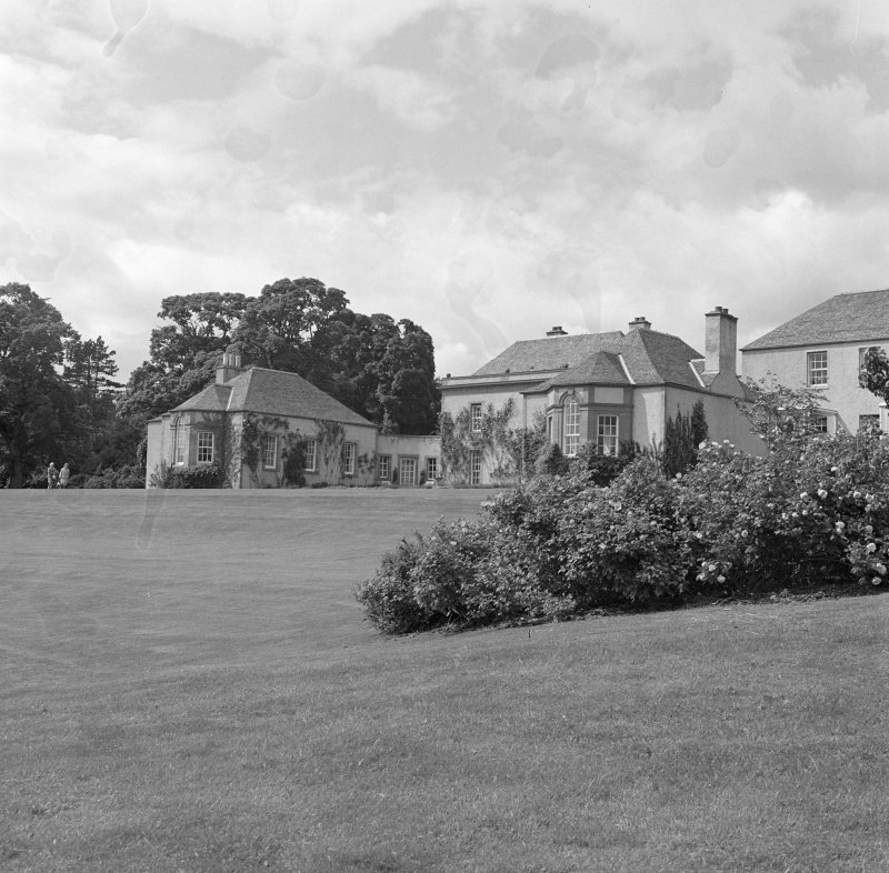 View of wings flanking core former farmhouse from E after Schomberg Scott remodelling.