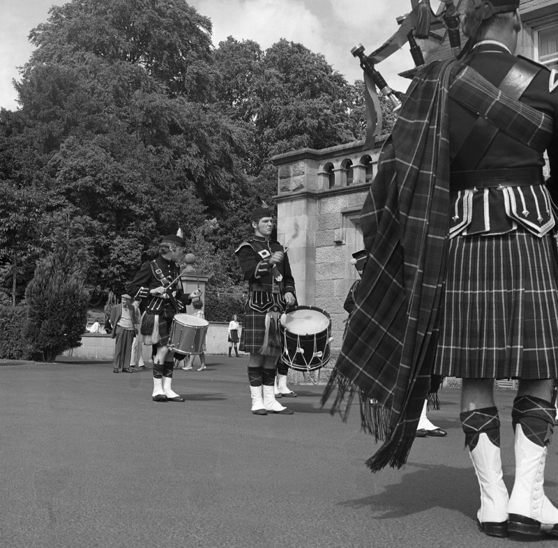 View of pipe band in N garden.