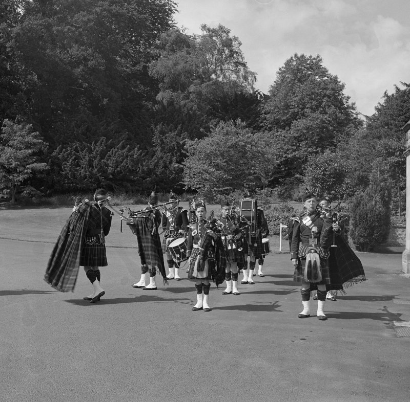 View of pipe band in grounds.