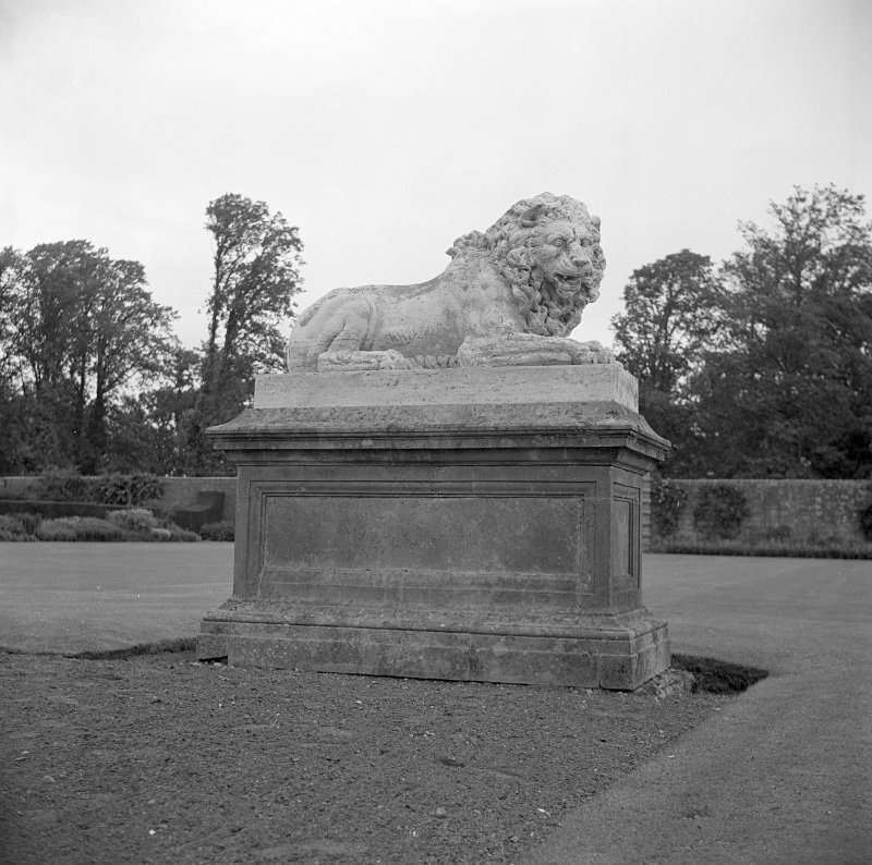 Detail of lion statue in garden