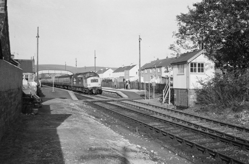 View of south signal box, footbridge and tracks, Brora Station.