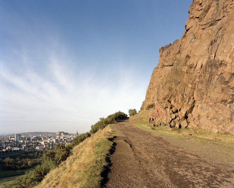 Holyrood Park: Salisbury Crags and Radical Road looking N, with Edinburgh Castle in background
