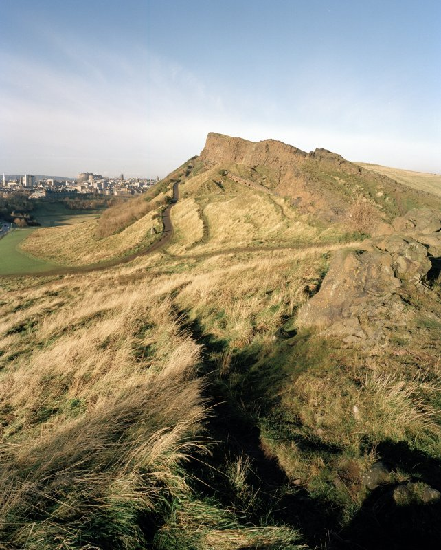 Holyrood Park: S end of Salisbury Crags, with city of Edinburgh behind
