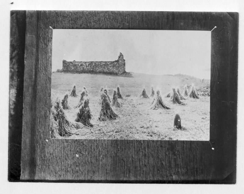 Copy of a historic photographic view of St Donnan's Church, Kildonnan, with hay bales in the foreground. Taken from The Banff Album.
