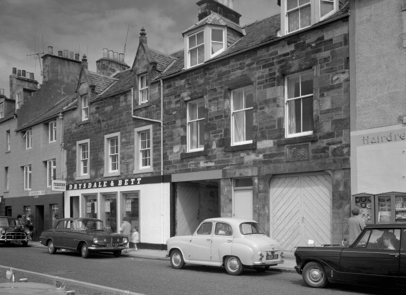 View of 37-39 Shore Street, Anstruther Easter, from S, showing the premises of Drysdale & Bett.