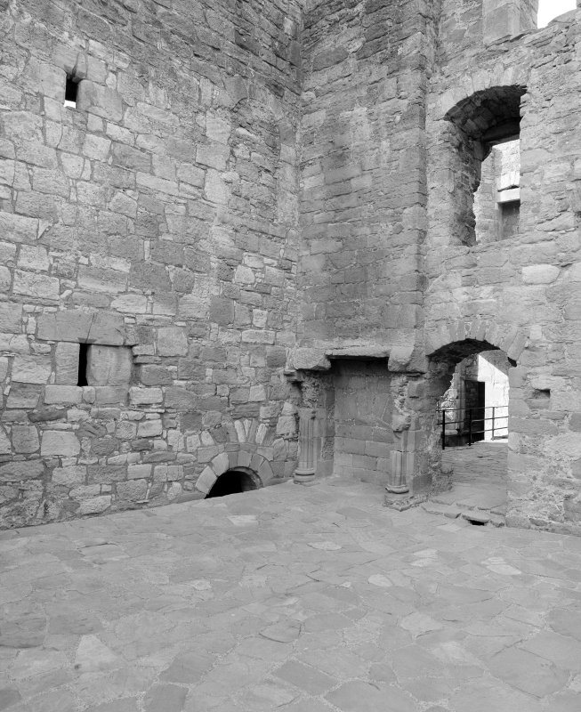 View of withdrawing room showing remains of doorways into original tower house, Crichton Castle.