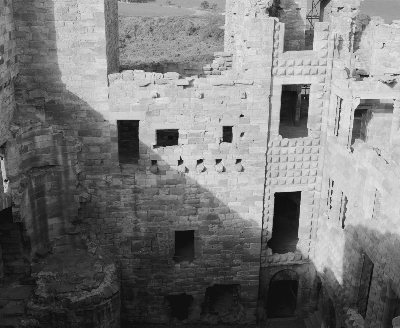 View of north and west ranges looking downwards into courtyard, Crichton castle.