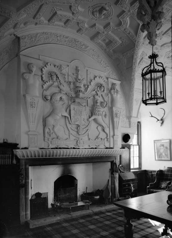 Interior view of Craigievar Castle showing fireplace in hall.