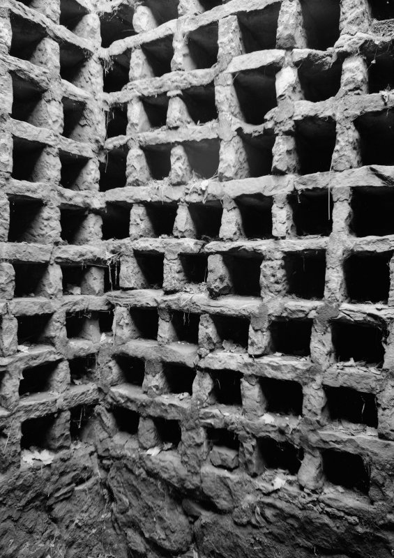 Interior view of Pitreavie Castle Dovecot showing nesting boxes.