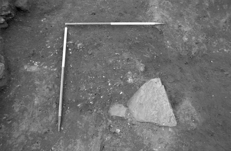 Excavation photograph : square clay/soil feature, from E.