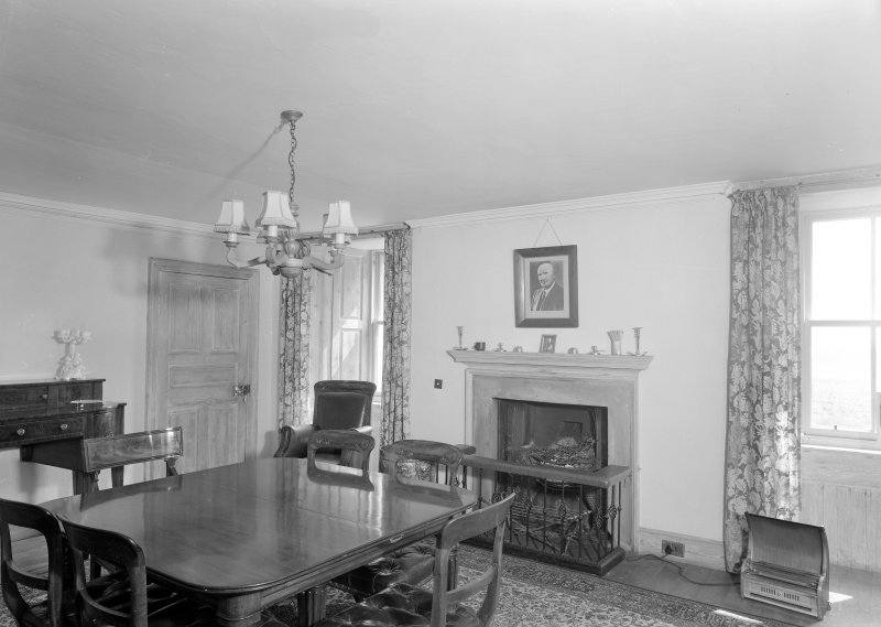 Interior view of Wedderlie House showing dining room with fireplace.