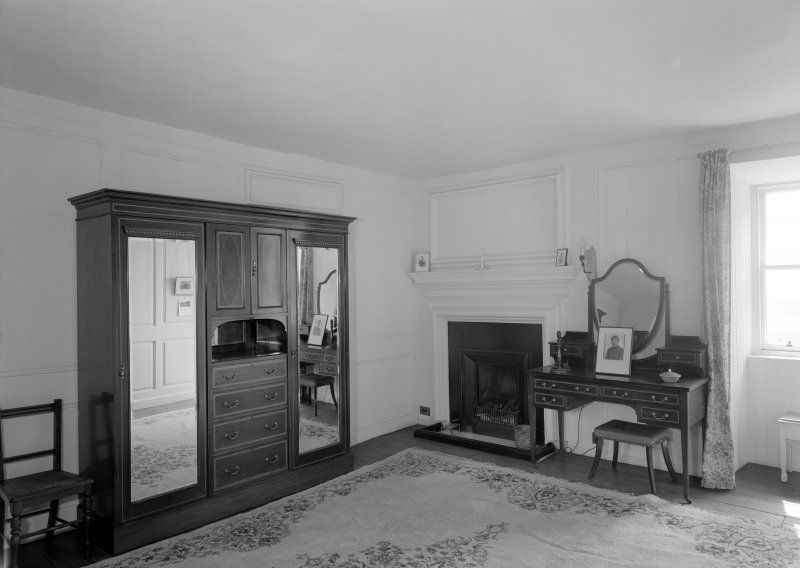 Interior view of Wedderlie House showing first floor bedroom with fireplace.