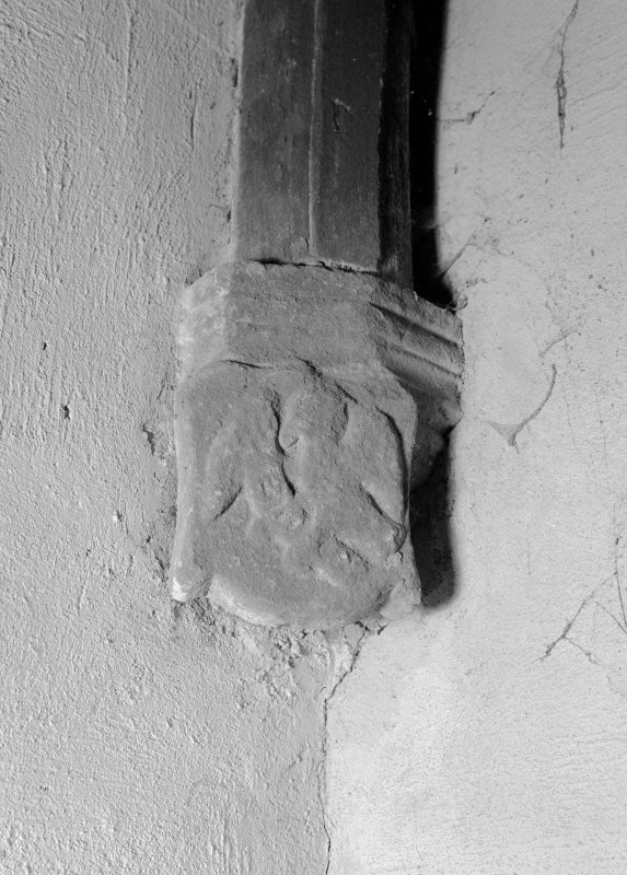 Interior view of Towie Barclay Castle showing corbel stop with one of the four evangelists in gallery of Great Hall.