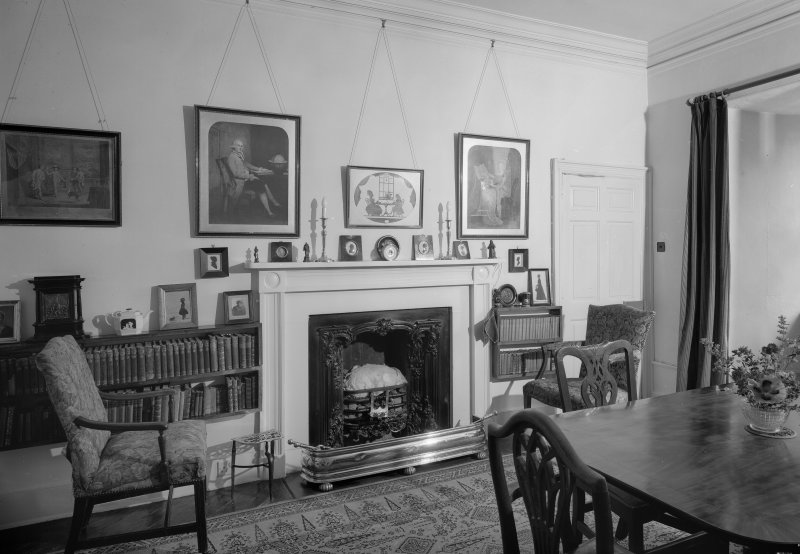 Interior view of Barra Castle showing room with fireplace.