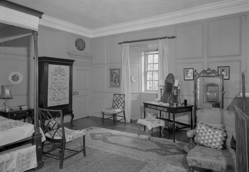 Interior view of Barra Castle showing bedroom with Cockpen chairs.