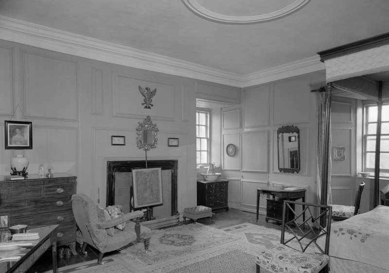 Interior view of Barra Castle showing bedroom with fireplace.