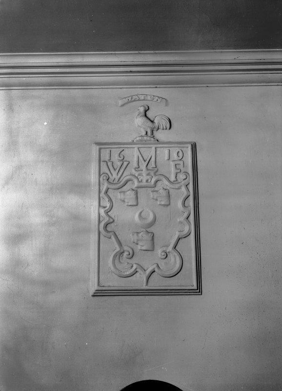 Interior view of Craigievar Castle showing detail of heraldic panel in landing to Blue Room.