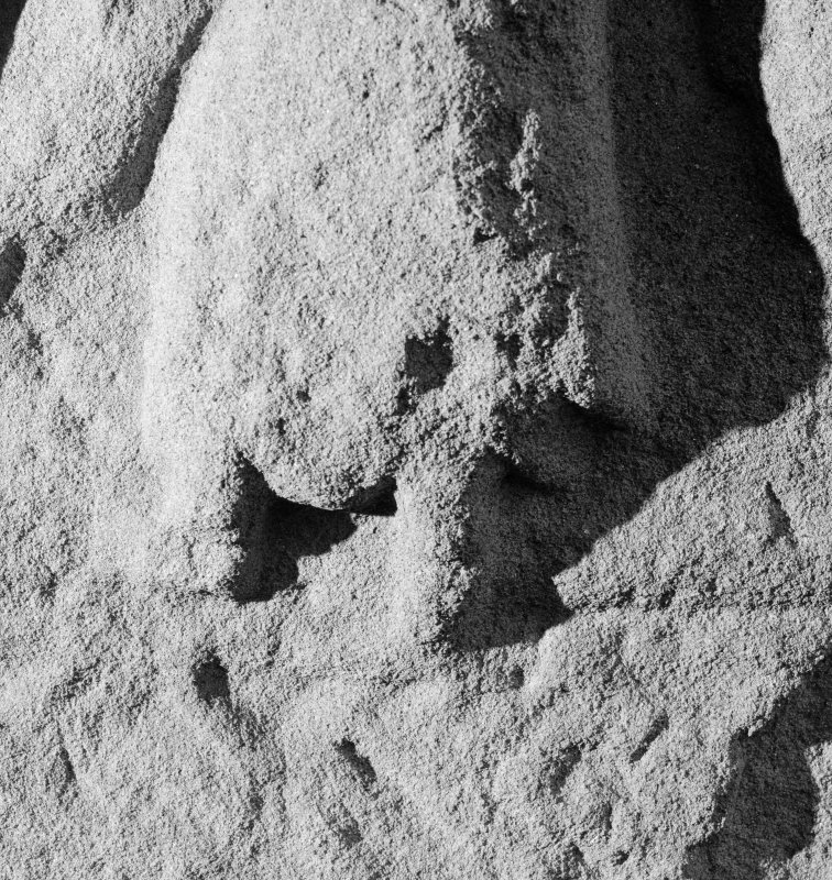 Detail of Pictish cross-slab Aberlemno 3, showing lower part of right-hand angel on face A.