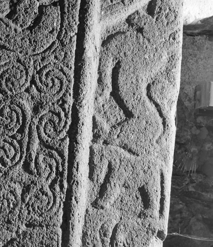 Detail of cross-slab at Ardchattan, showing animals on the right of the cross-shaft on face A.