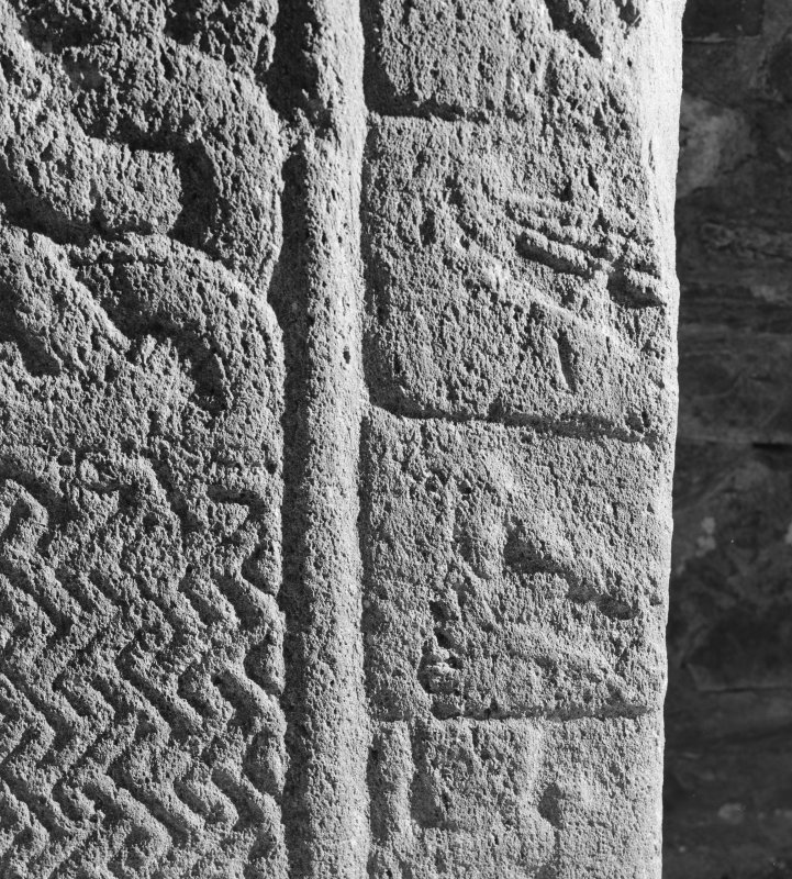 Detail of cross-slab at Ardchattan, showing musicians and warrior on the right of the cross-shaft on face A.