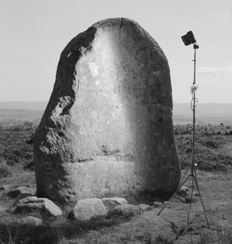 View of standing stone with small incised cross at Fowlis Wester showing camera and flash set up.