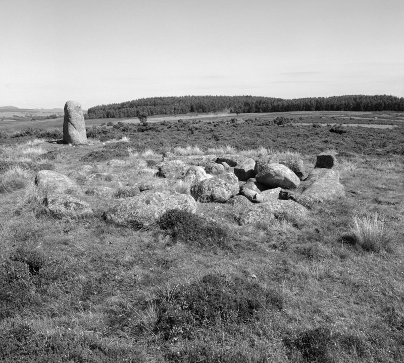 View of cairn and standing stone at Fowlis Wester.