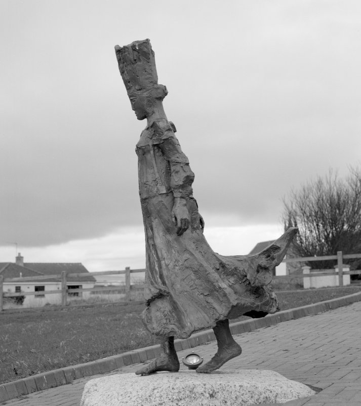 View of modern bronze scupture, Pictish Princess, at Portmahomack.