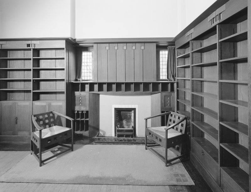 Hill House, Helensburgh. Interior. View of library, fireplace and overmantel with chairs