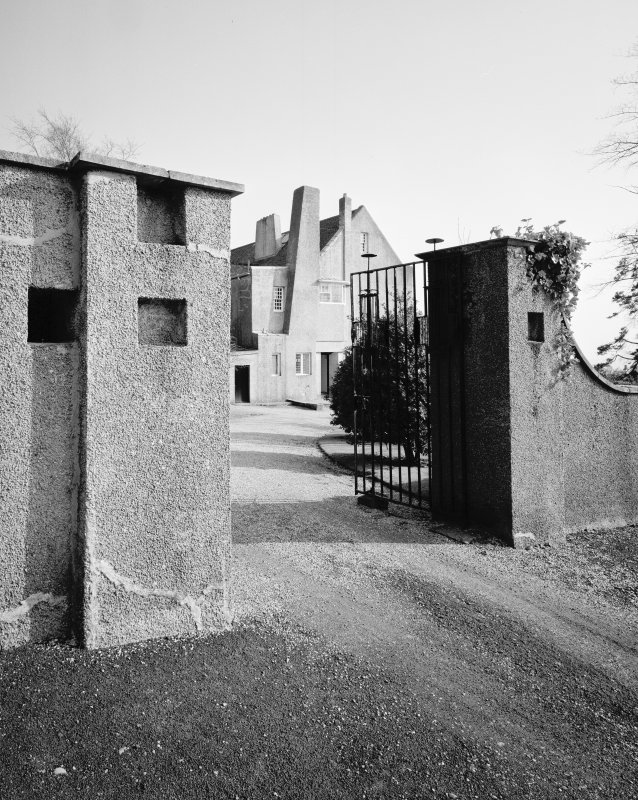 Hill House, Helensburgh.  View of entrance gates and piers, from North West