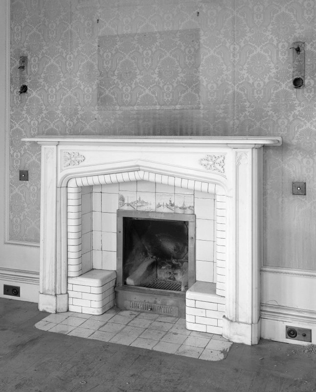 Interior. Detail of fireplace in ground floor North-East apartment.