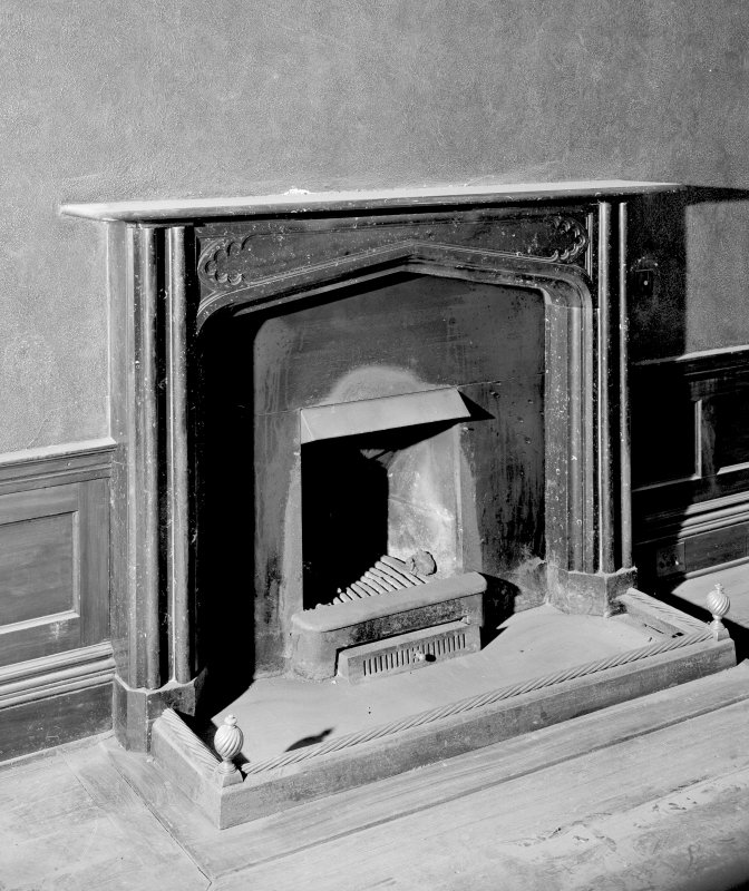 Interior. Detail of fireplace in ground floor South-East apartment.
